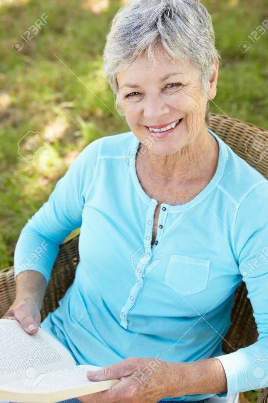Senior woman reading a book Stock Photo - 11239084
