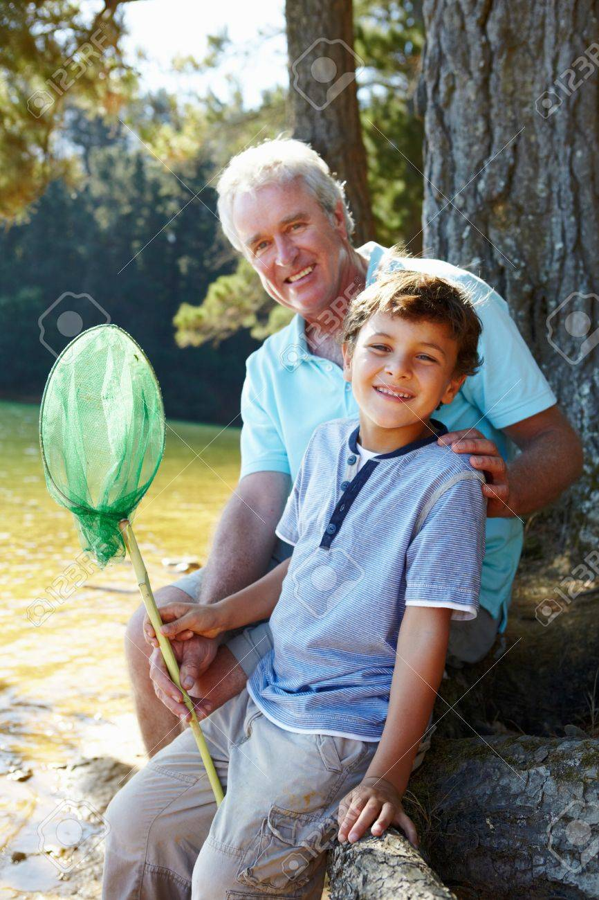 Man and boy fishing together Stock Photo - 11239112