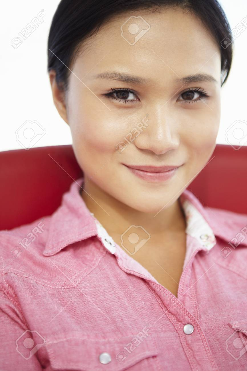 Young woman sitting in chair Stock Photo - 11238997