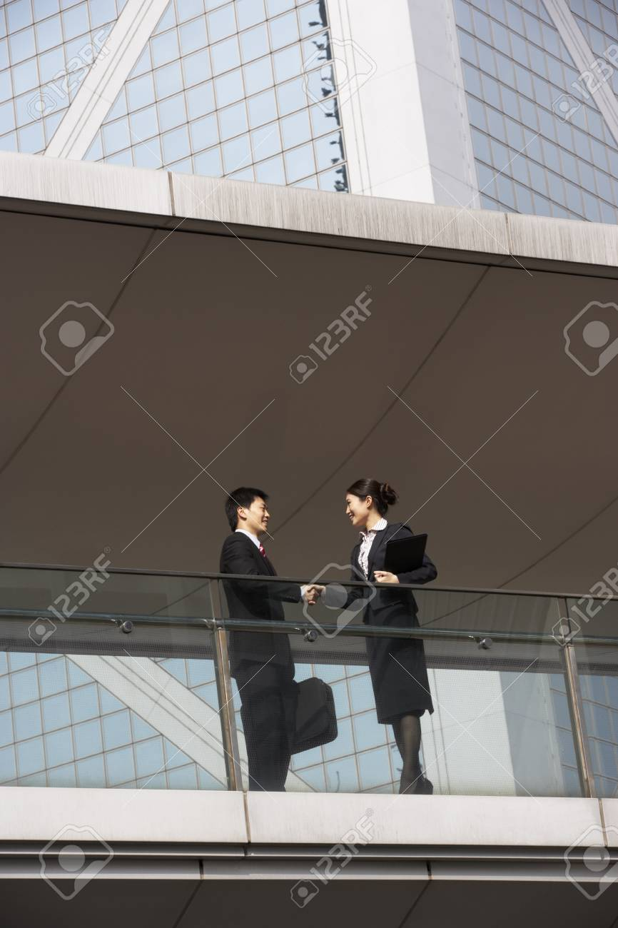 Two Business Colleagues Shaking Hands Outside Office Building Stock Photo - 18709738