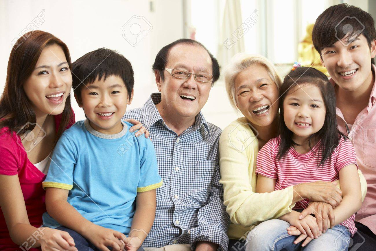 Portrait Of Multi-Generation Chinese Family Relaxing At Home Together - 18710604