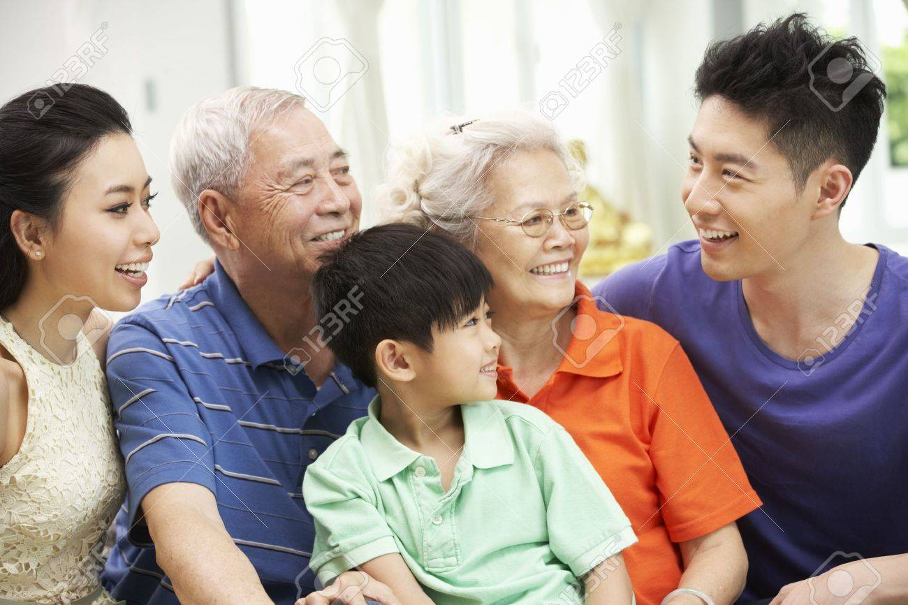 Portrait Of Multi-Generation Chinese Family Relaxing At Home Together Stock Photo - 18709952