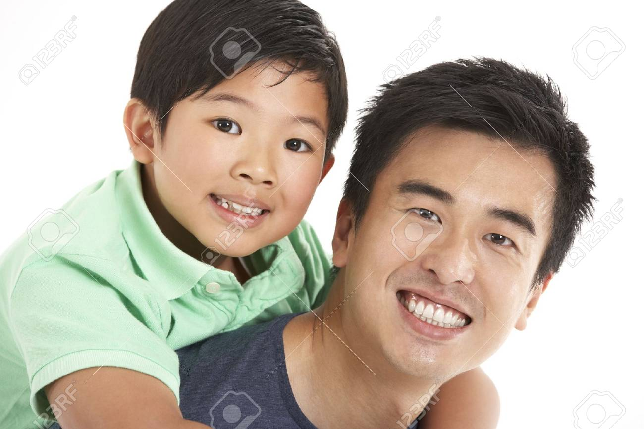 Studio Shot Of Chinese Father And Son Stock Photo - 18709490