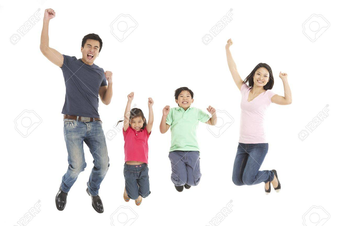 Studio Shot Of Chinese Family Jumping In Air - 18709214