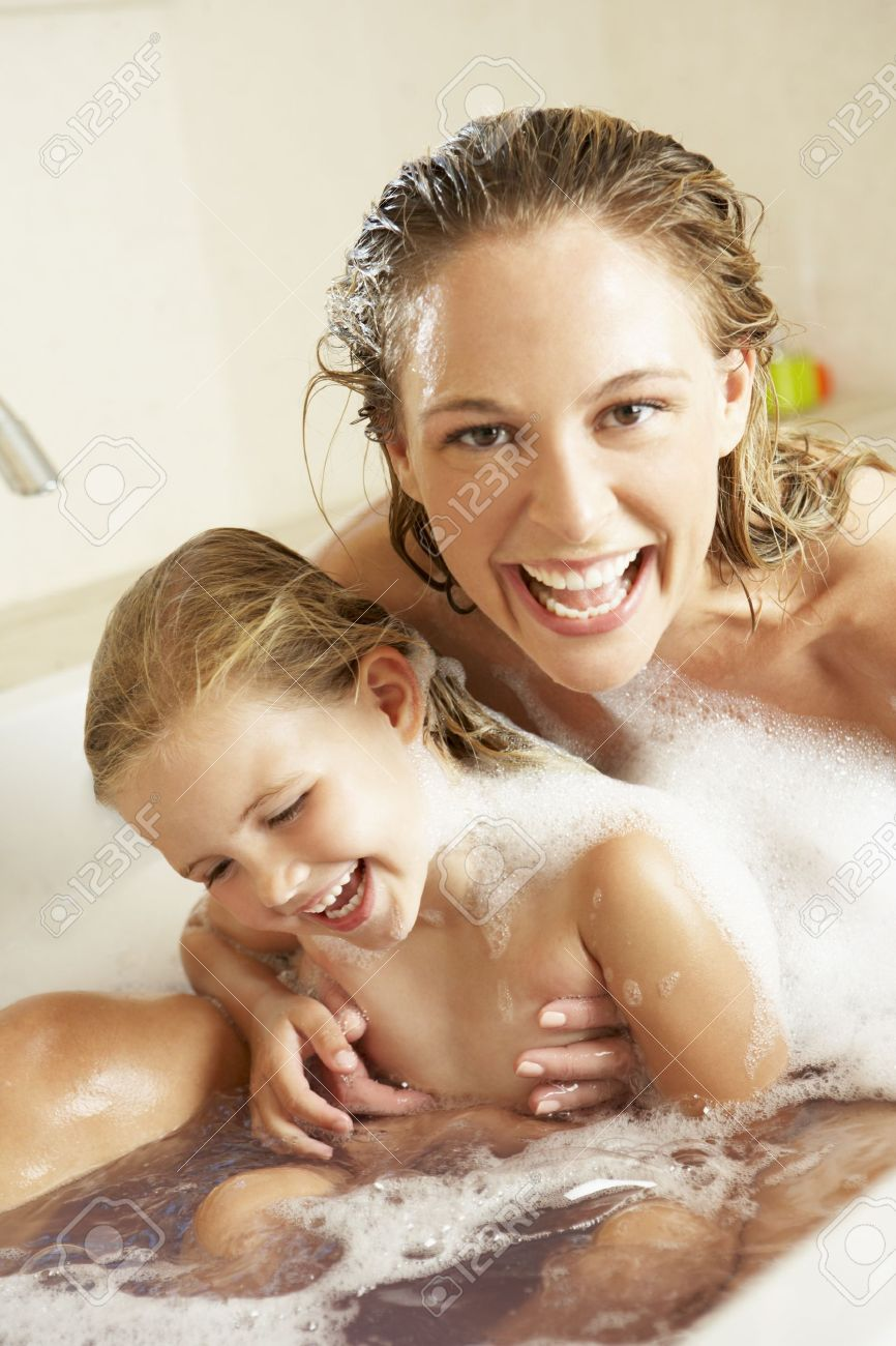 Mother And Daughter Relaxing In Bubble Filled Bath Stock Photo ...