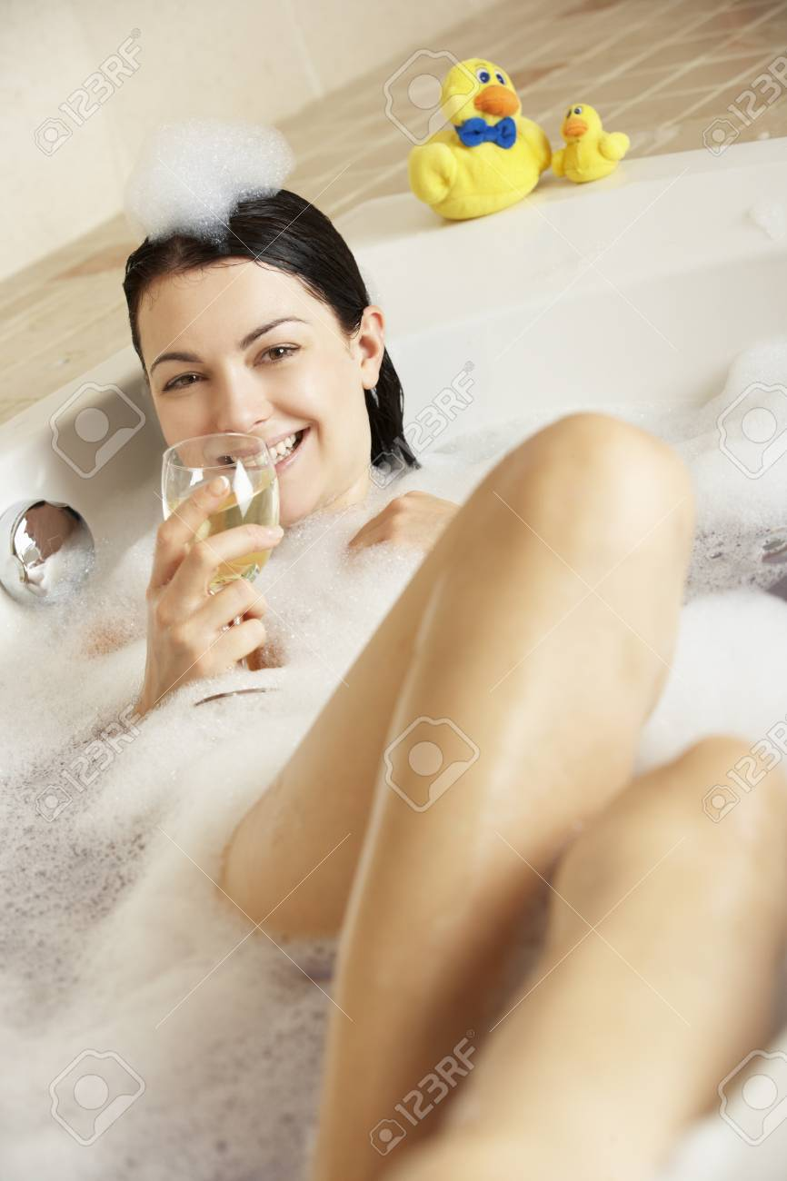 Woman Relaxing With Glass Of Wine In Bubble Filled Bath Stock Photo - 18719081