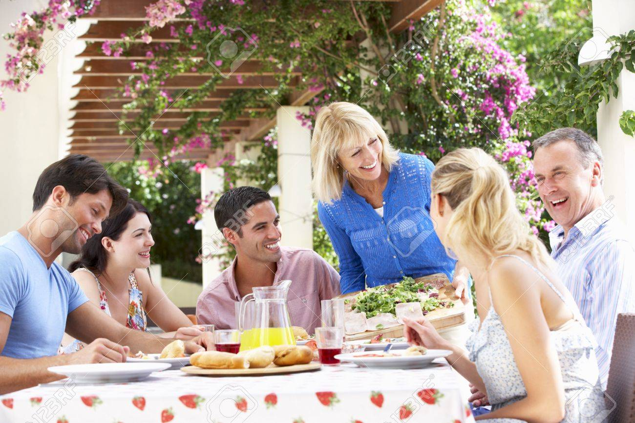 Group Of Young And Senior Couples Enjoying Family Meal Stock Photo - 18722988