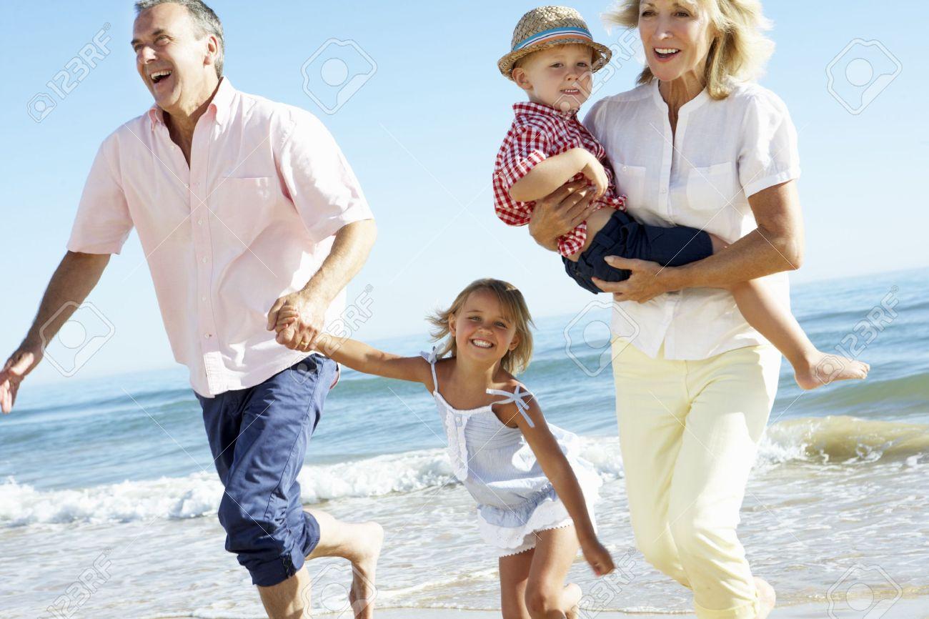 Grandchild: Grandparents And Grandchildren Enjoying Beach Holiday Get  Quotations · How To Buy Stocks