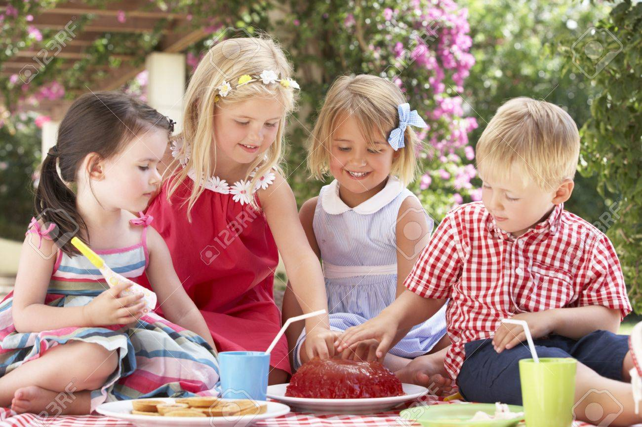 Group Of Children Eating Jelly At Outdoor Tea Party Stock Photo - 18722996