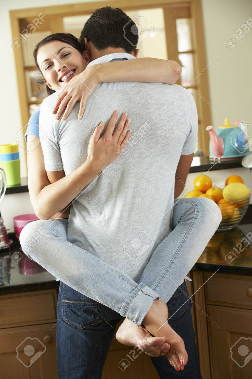 Romantic Couple Hugging In Kitchen Stock Photo, Picture And Royalty ...