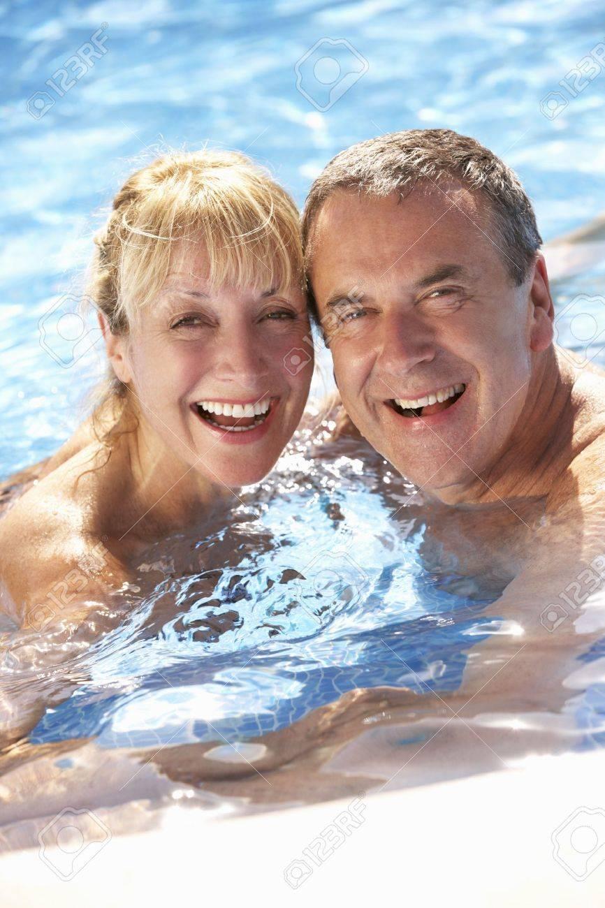 Senior Couple Having Fun In Swimming Pool Stock Photo - 18721196