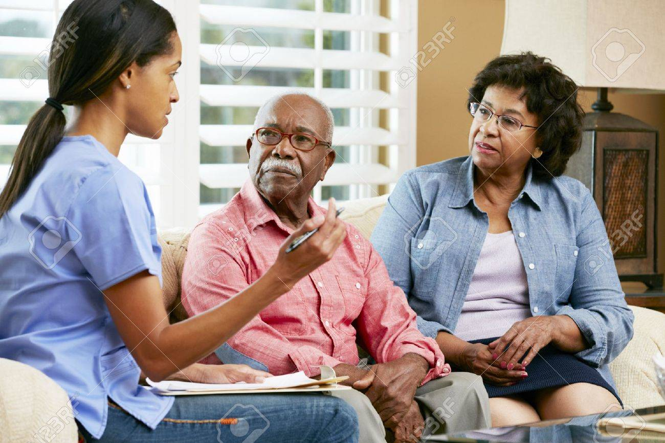 Nurse Making Notes During Home Visit With Senior Couple Stock Photo - 18735696