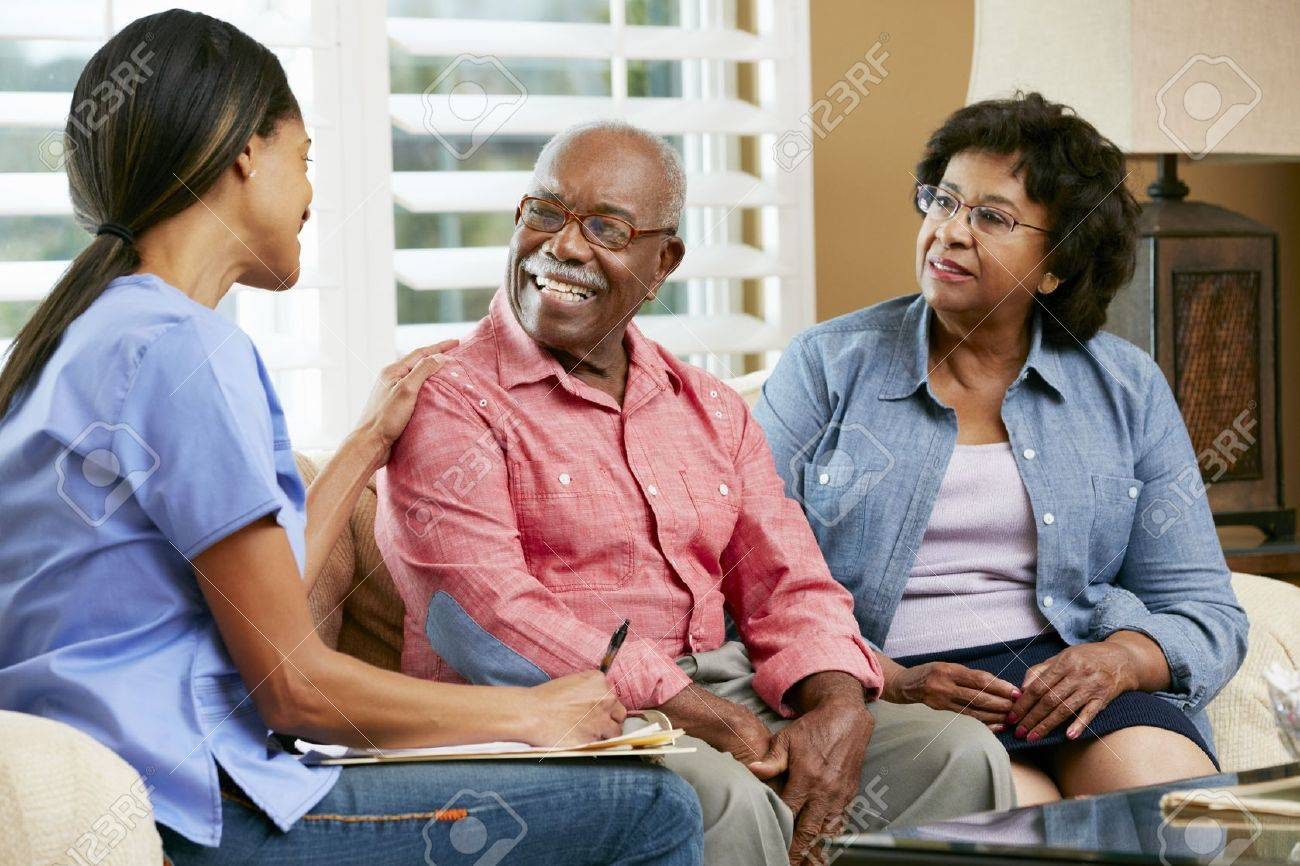 Nurse Making Notes During Home Visit With Senior Couple Stock Photo - 18735702