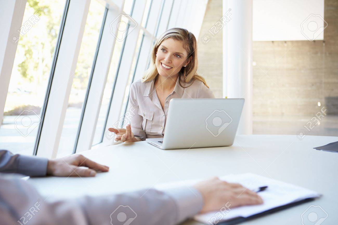 Business people Having Meeting Around Table In Modern Office Stock Photo - 18735481