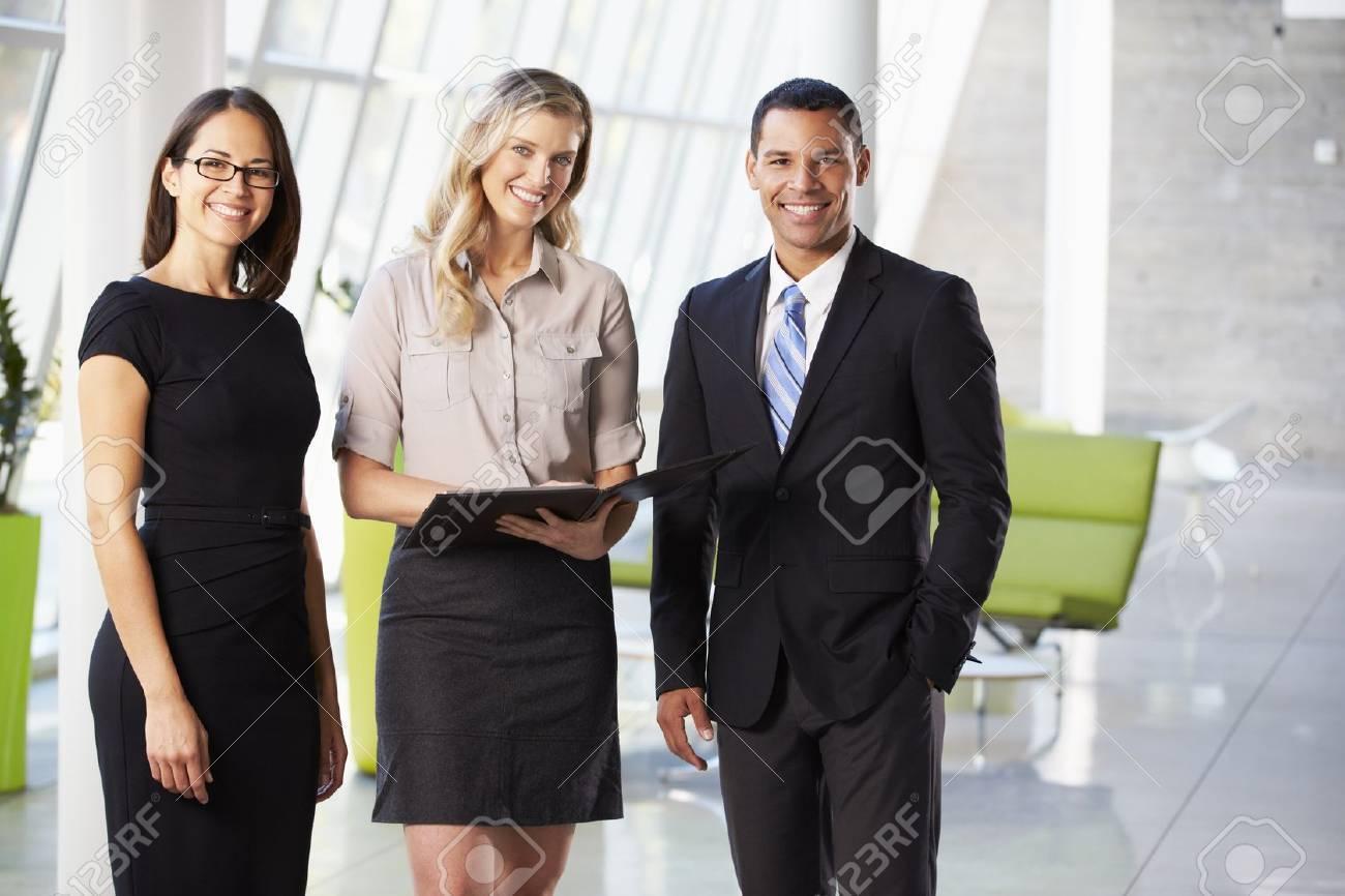 Businesspeople Having Informal Meeting In Modern Office Stock Photo - 18736512