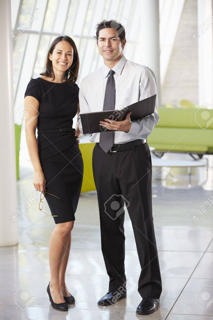Businessman And Businesswomen Having Meeting In Office Stock Photo - 18736738