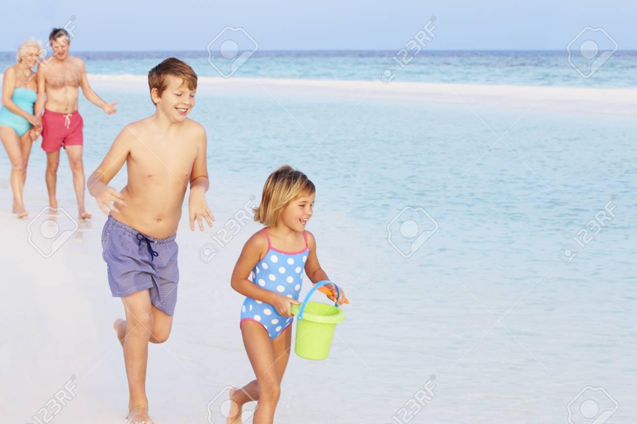 Grandparents And Grandchildren Having Fun On Beach Holiday Stock Photo - 19530399