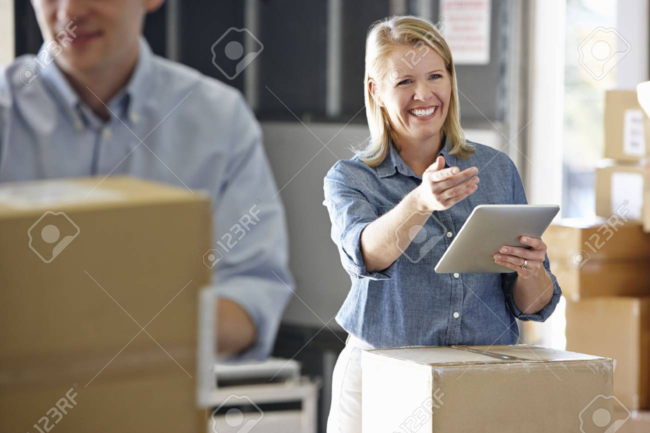 Manager Using Tablet Computer In Distribution Warehouse Stock Photo - 19530570