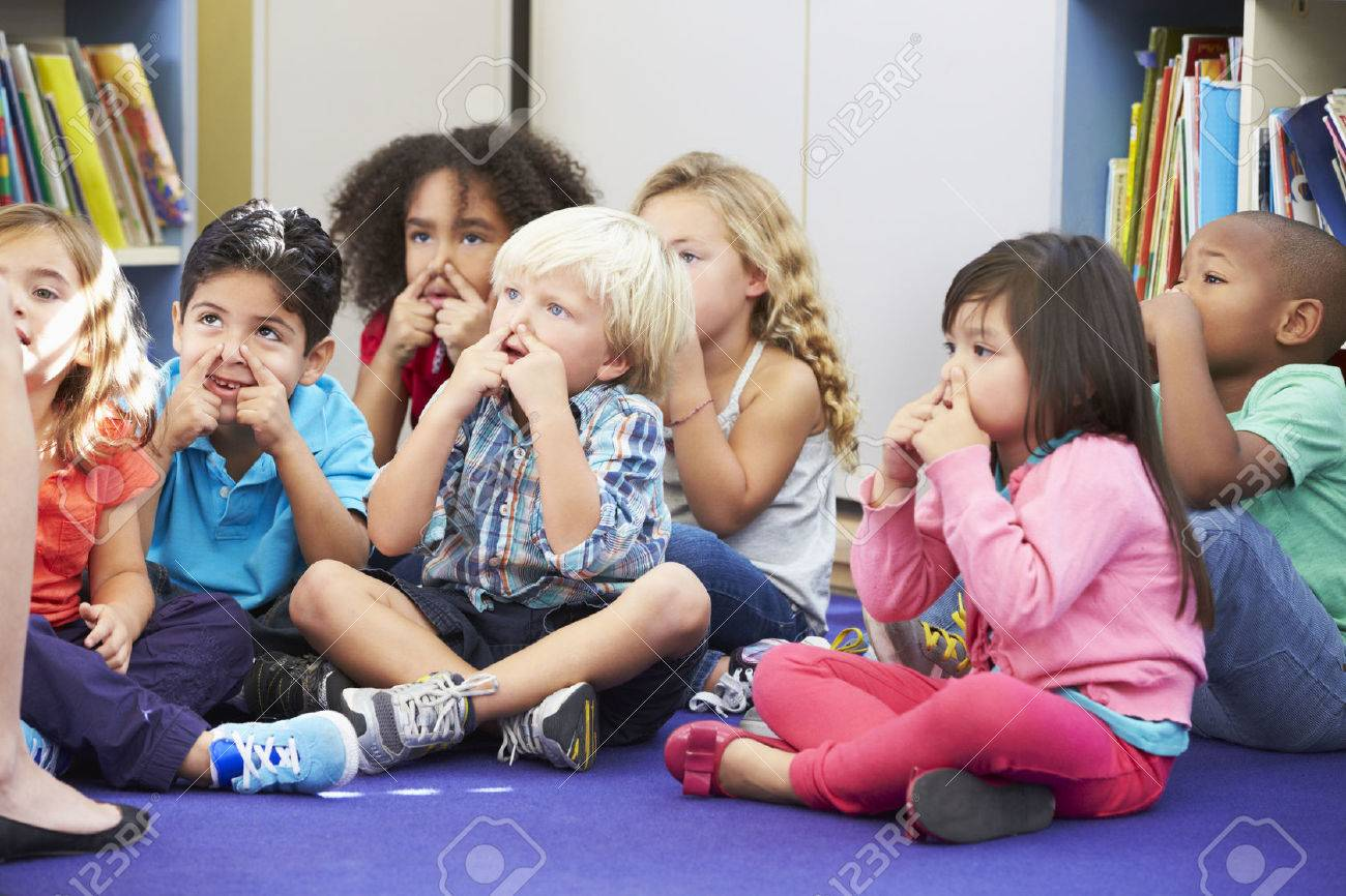 Group of Elementary Pupils In Classroom Touching Noses Stock Photo - 24488373