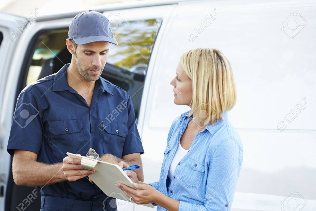 Customer Signing For Delivery From Courier - 24490048
