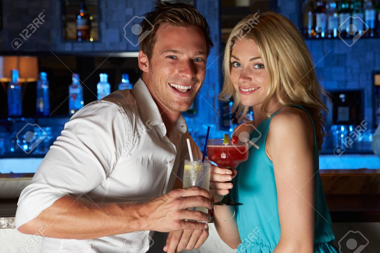 Couple Enjoying Cocktail In Bar Stock Photo - 24491919