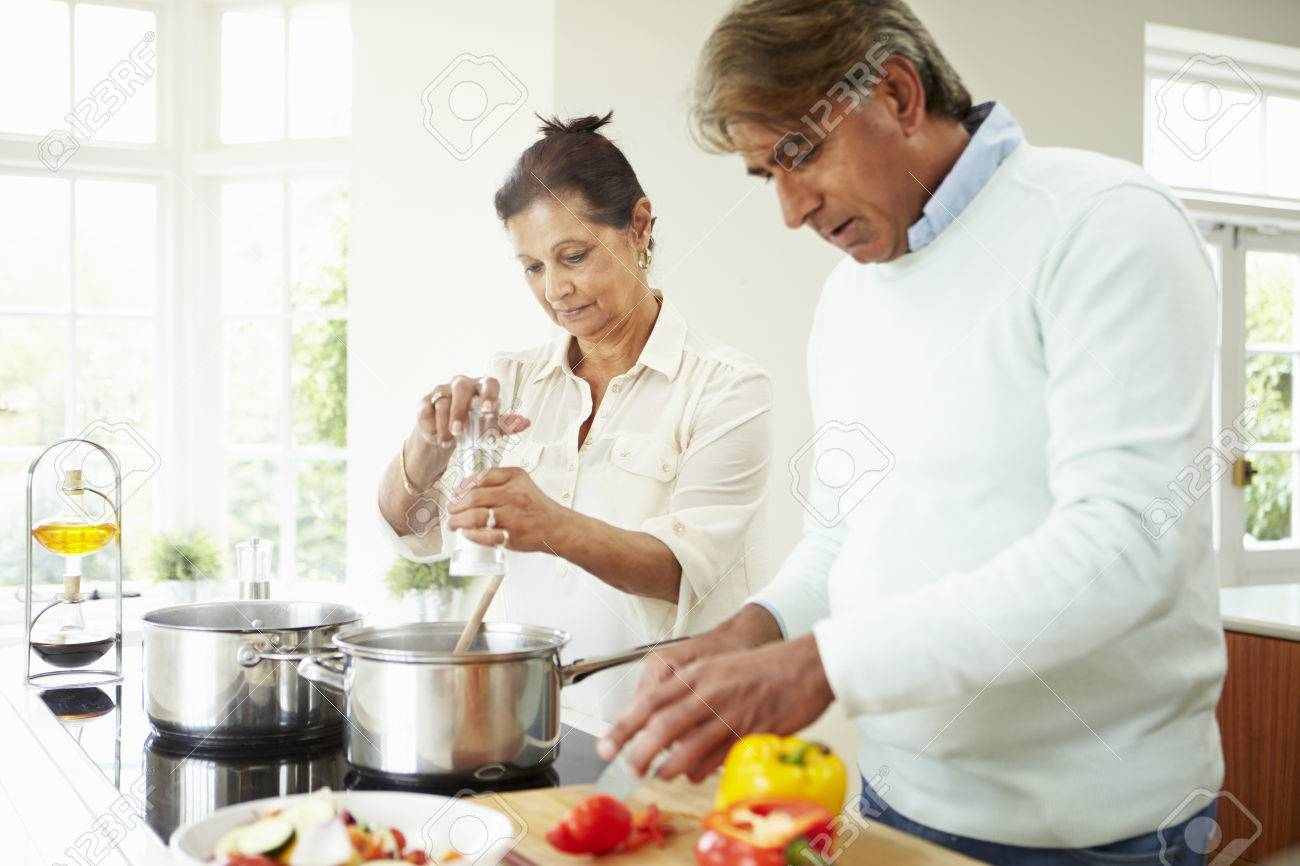 Senior Indian Couple Cooking Meal At Home Stock Photo Picture And