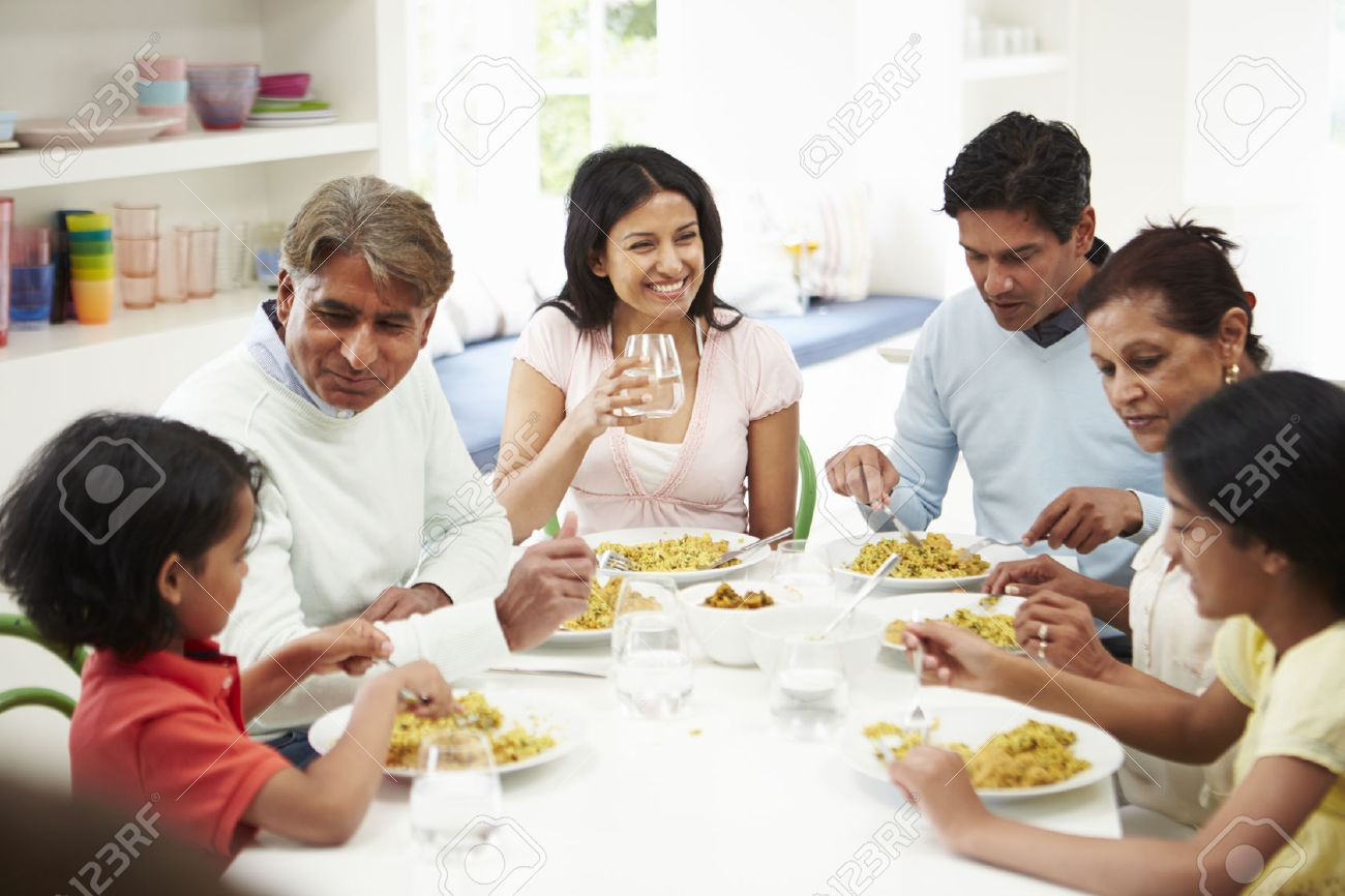 Multi Generation Indian Family Eating Meal At Home - 24508165