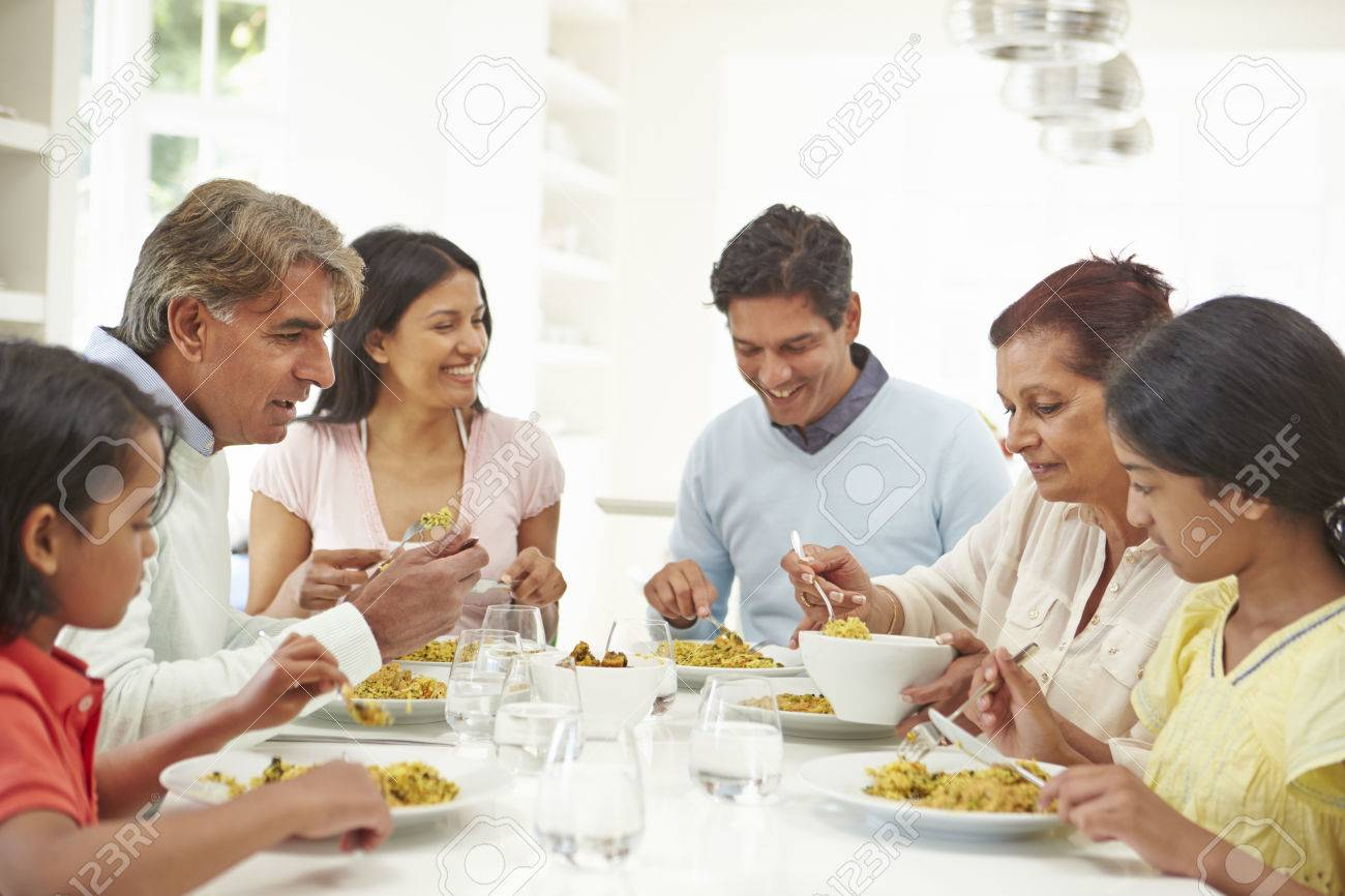 Multi Generation Indian Family Eating Meal At Home Stock Photo - 24508177