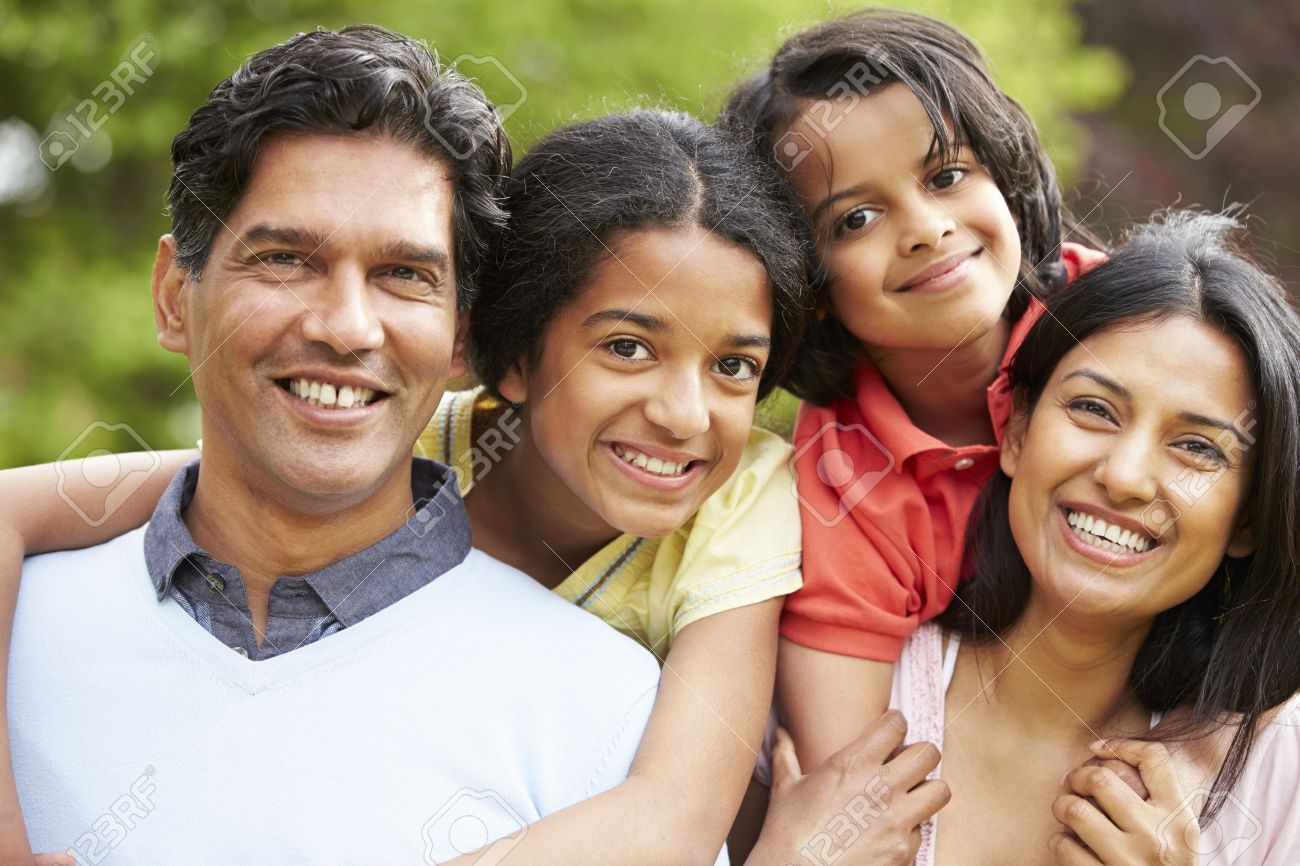 Indian Family Walking In Countryside Stock Photo - 24508306