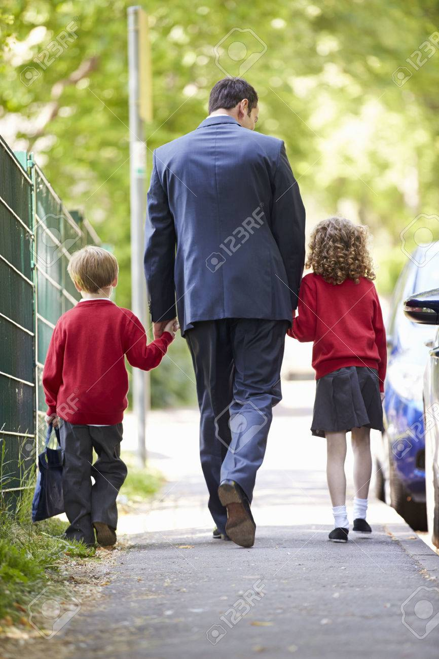 father walking to school children on way to work stock photo father walking to school children on way to work stock photo 30999994