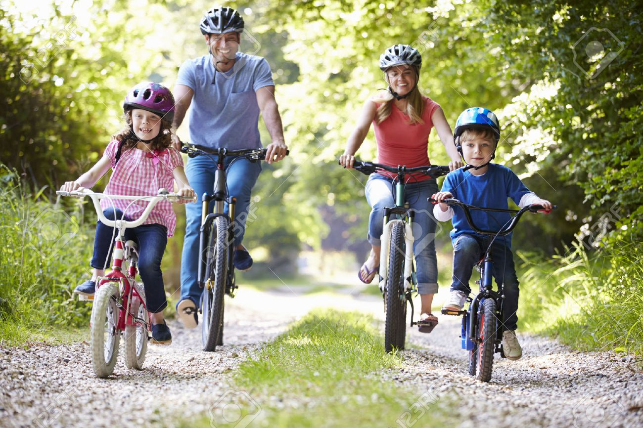 Family On Cycle Ride In Countryside Stock Photo - 31000431
