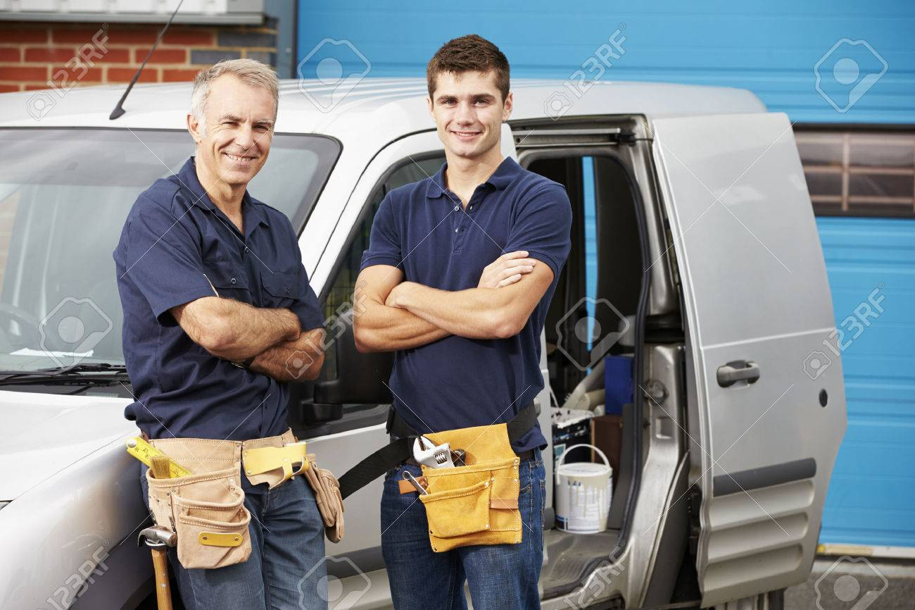 Workers In Family Business Standing Next To Van - 31009971