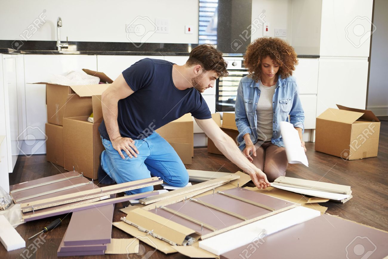 Superb Couple Putting Together Self Assembly Furniture In New Home Stock Photo    31010113