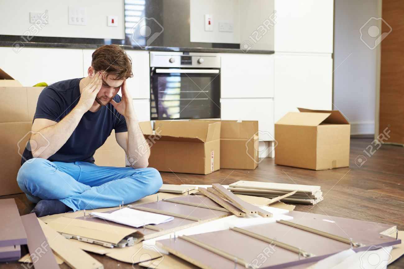 Frustrated Man Putting Together Self Assembly Furniture Stock Photo    31010152