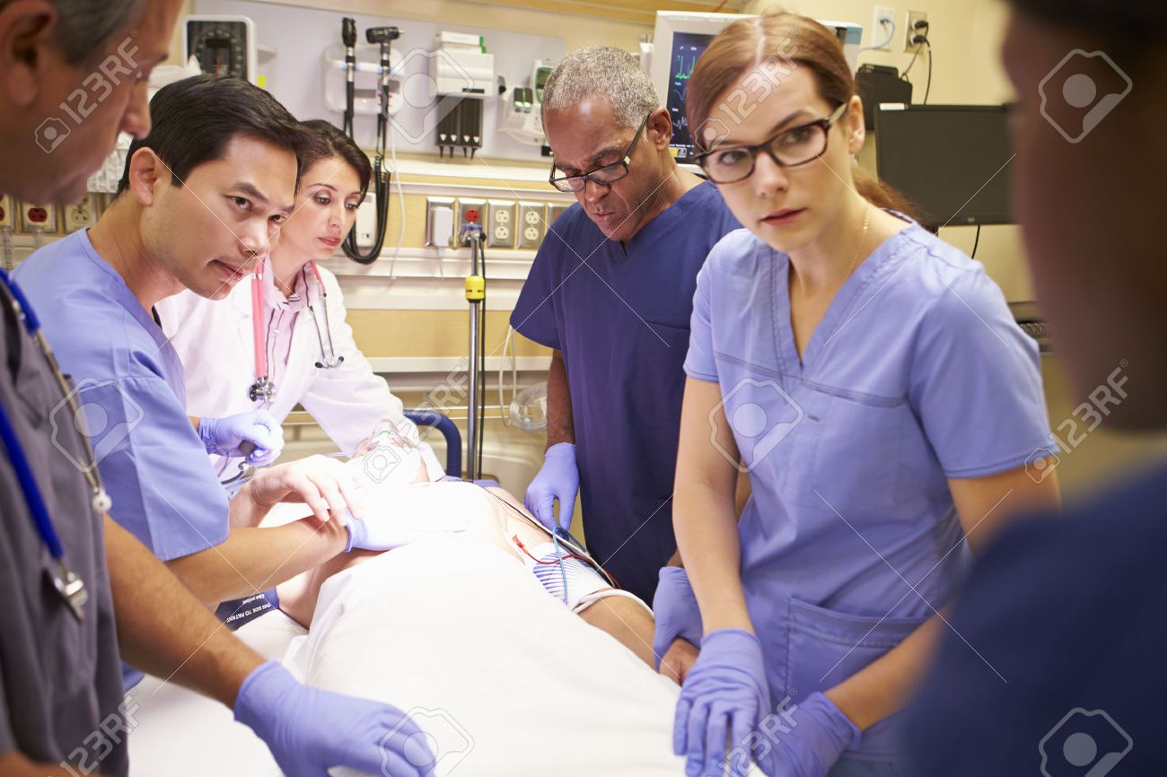 Medical Team Working On Patient In Emergency Room Stock Photo ...