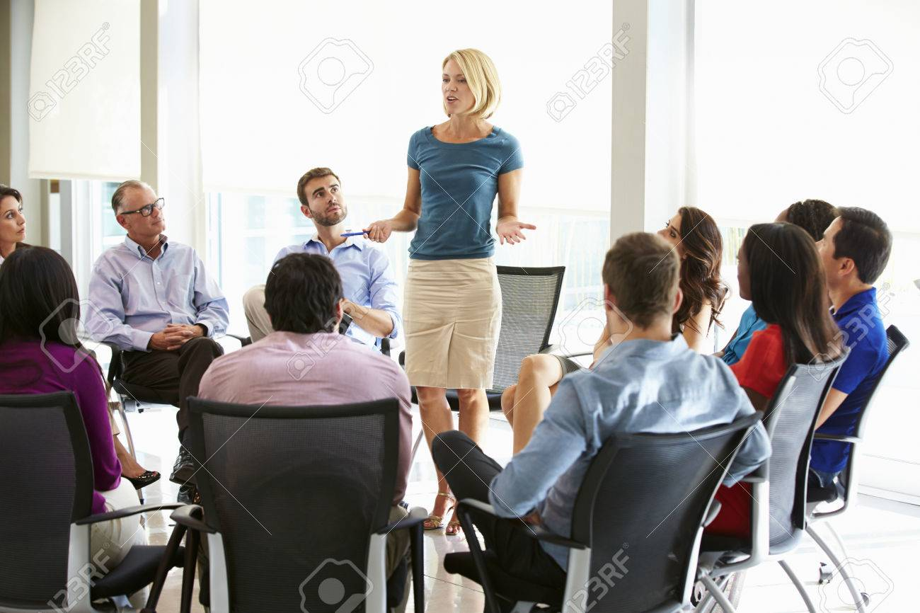Businesswoman Addressing Multi-Cultural Office Staff Meeting - 31047572