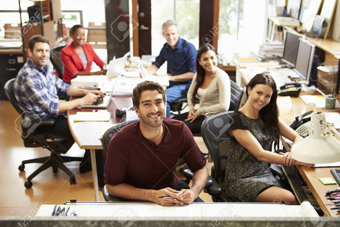Portrait Of Office Staff At Table In Architect's Office - 31050284