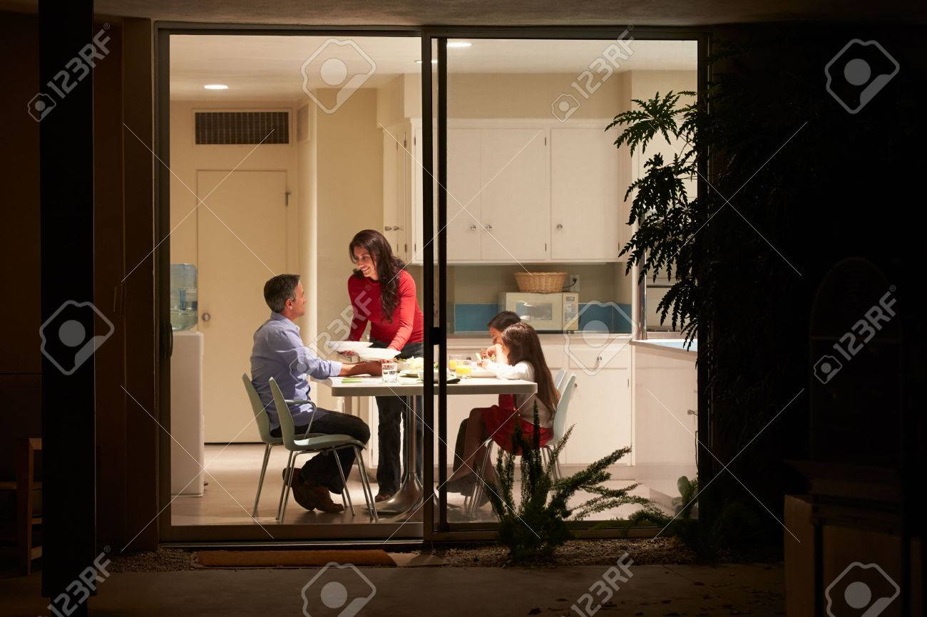 Window at night from outside - Family Eating Evening Meal Viewed From Outside Stock Photo 31066472