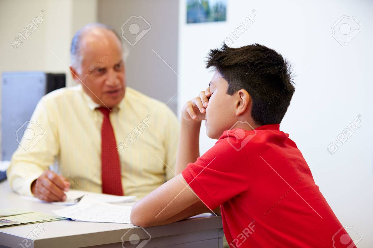 school interview images stock pictures royalty school school interview male student talking to high school counselor