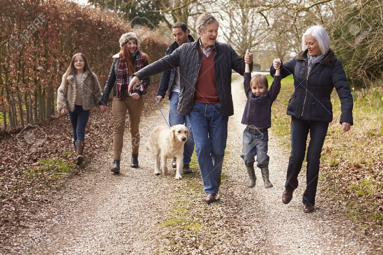 Multi Generation Family On Countryside Walk Stock Photo - 33526263