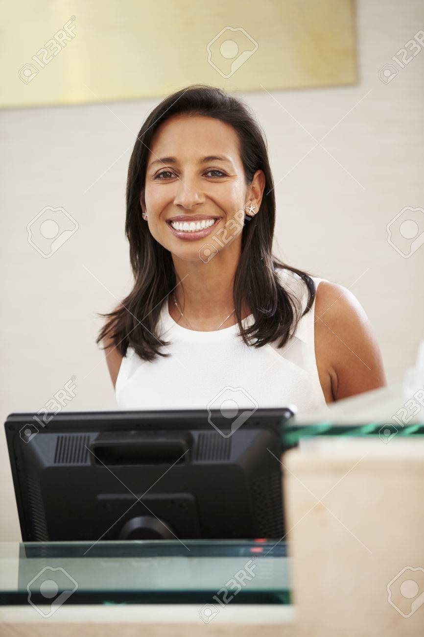portrait of female receptionist at hotel front desk stock photo portrait of female receptionist at hotel front desk stock photo 33545987