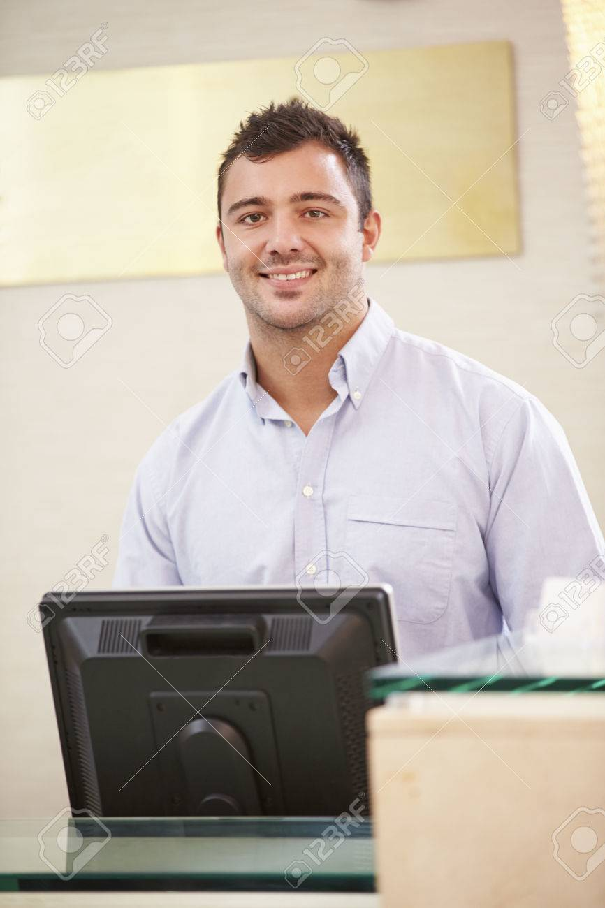 portrait of male receptionist at hotel front desk stock photo portrait of male receptionist at hotel front desk stock photo 33546906