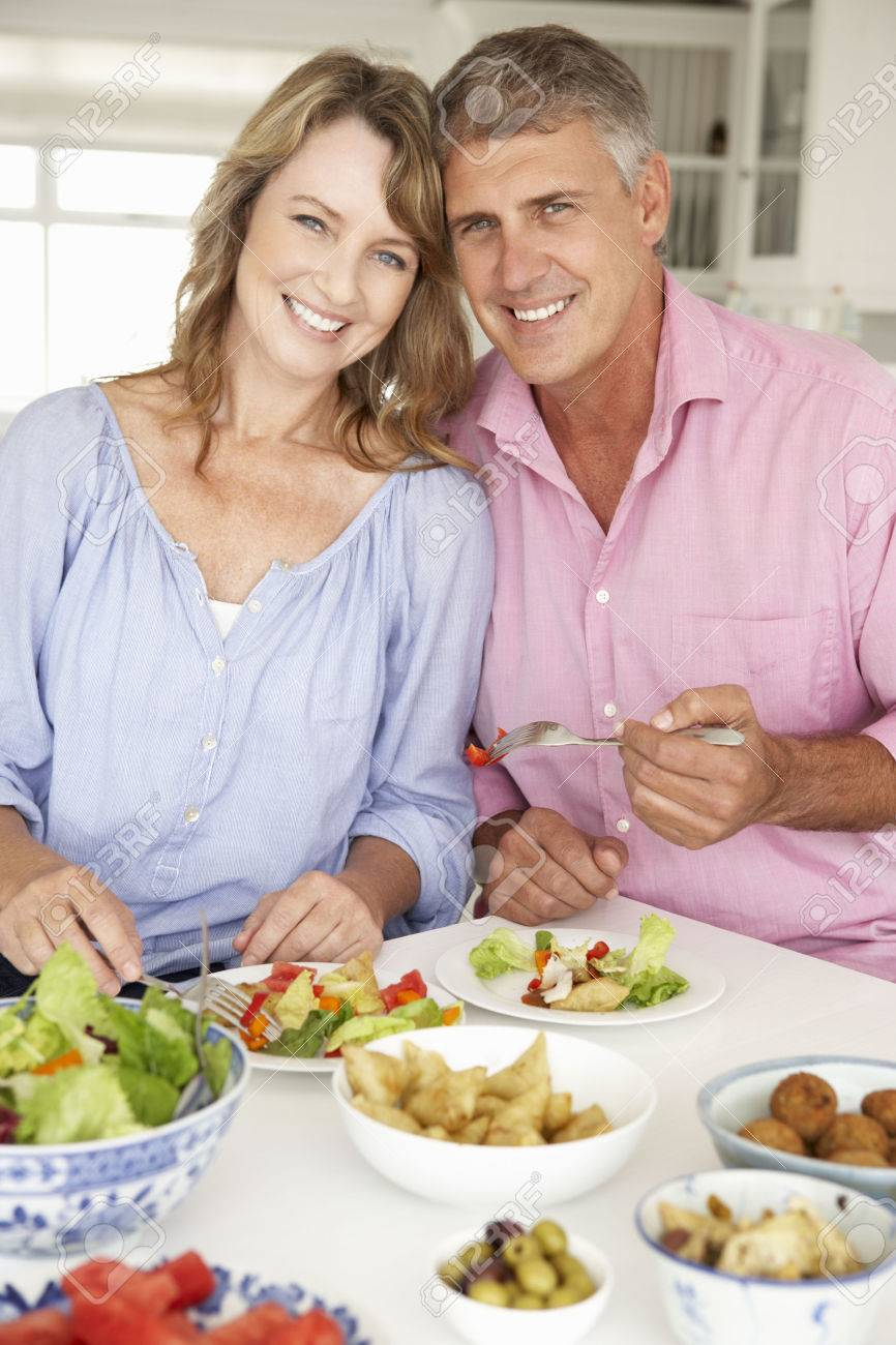33551886-mid-age-couple-enjoying-meal-at-home.jpg