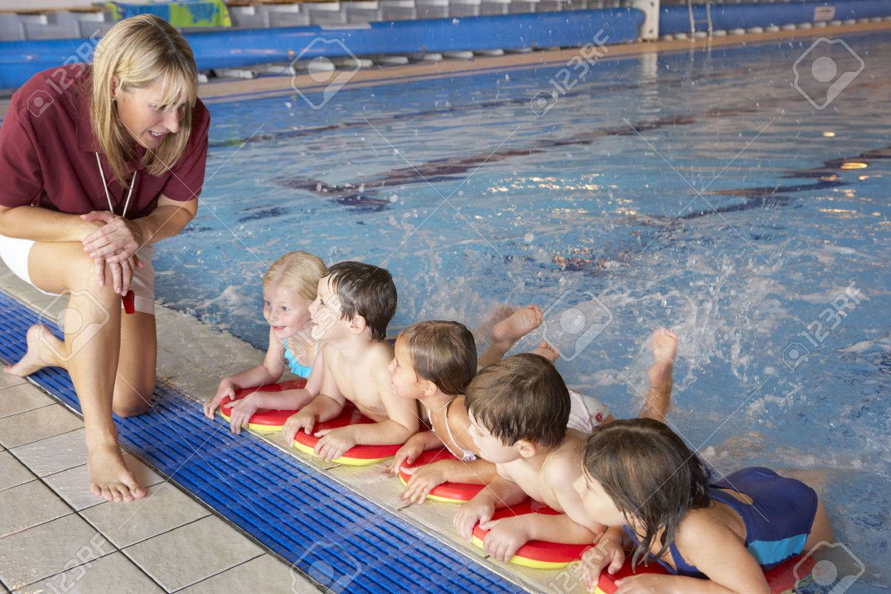 Children having swimming lesson - 33604628