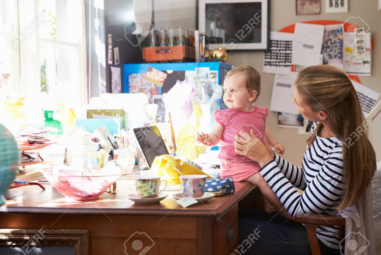 running home office. Mother With Daughter Running Small Business From Home Office Stock Photo - 41392848 W