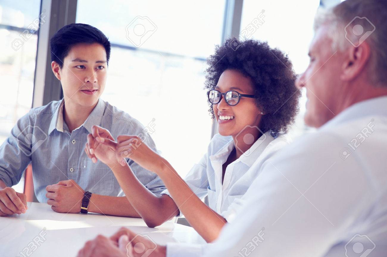 Three business professionals working together Stock Photo - 41392875