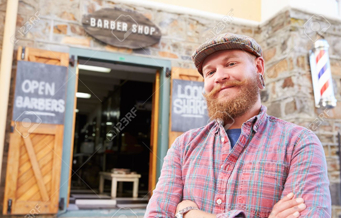 Portrait Of Hipster Barber Standing Outside Shop Stock Photo - 41393191