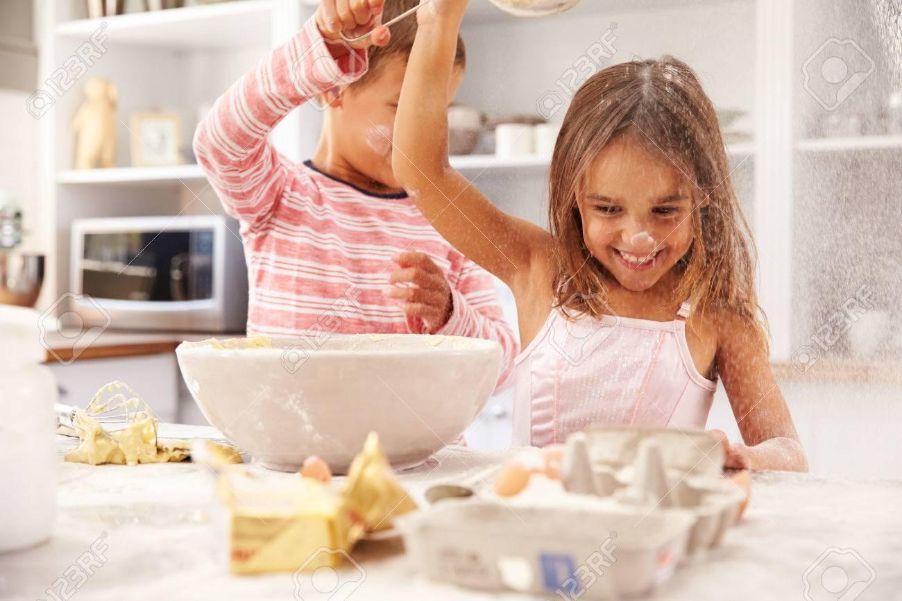 Two children having fun baking in the kitchen - 41393318