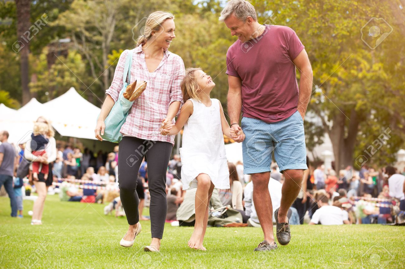 Family Relaxing At Outdoor Summer Event Stock Photo - 42131696