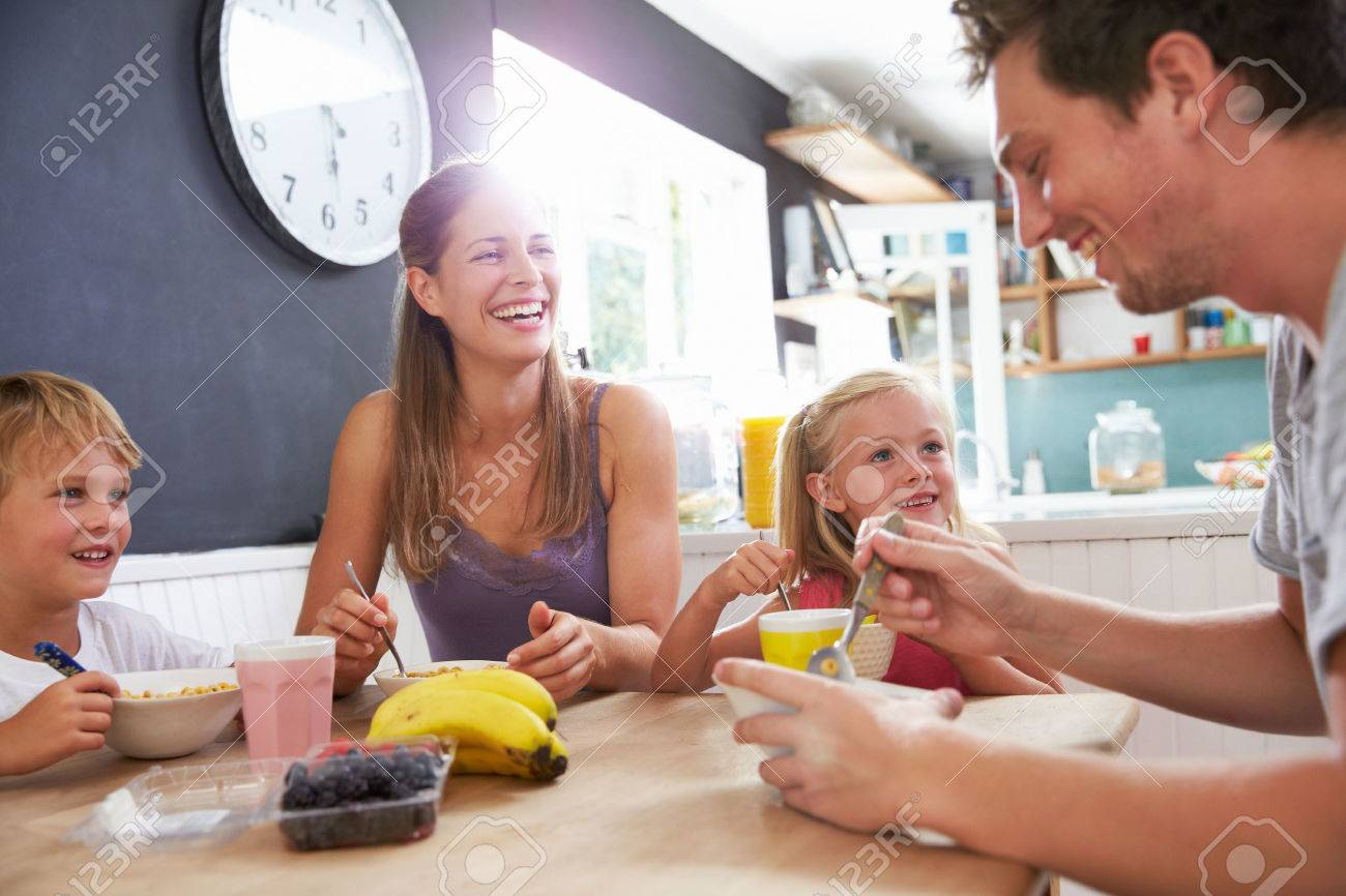 Family Eating Breakfast At Kitchen Table - 41461659
